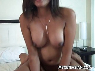 Alluring and ripe Asian bimbo gets her pussy plowed