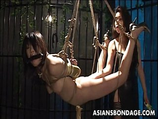 Bound Asian chick endures a nasty BDSM threesome